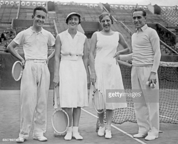 Undated picture showing French tennis players smiling after a training at Roland Garros stadium, from left to right: André Merlin, Colette Rosembert,...