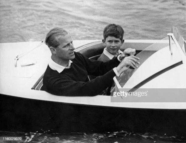 Undated picture showing Prince Charles of Wales with his father Prince Philip of Edinburgh on board a boat