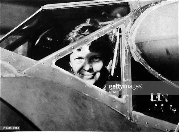 Undated picture taken in the 30' s of American female aviator Amelia Earhart looking trough the cockpit window of her plane Amelia Earhart was the...