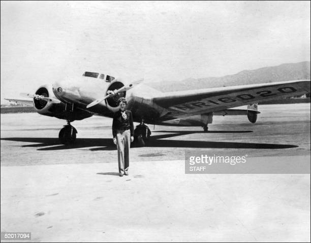 Undated picture taken in the 30' s of American female aviator Amelia Earhart in front of her plane Amelia Earhart was the first woman to fly the...