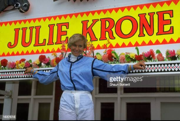 Portrait of Jockey Julie Krone of the USA standing in front of her name in neon lights Mandatory Credit Shaun Botterill/Allsport