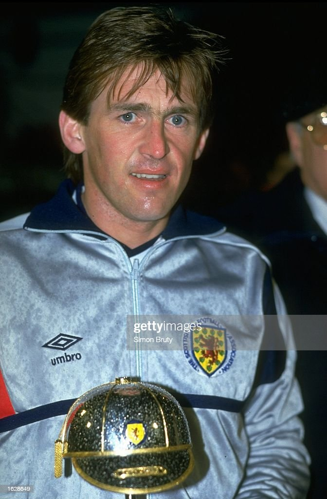 Portrait of Kenny Dalglish of Scotland holding his award for achieving his 100th cap. \ Mandatory Credit: Simon Bruty/Allsport