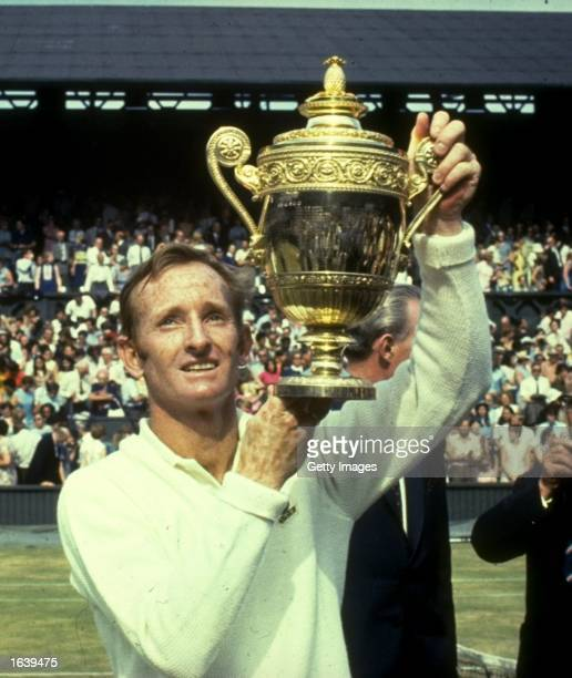Rod Laver of Australia holds the trophy aloft after his victory in the Men's Singles event at the Lawn Tennis Championships at Wimbledon in London...