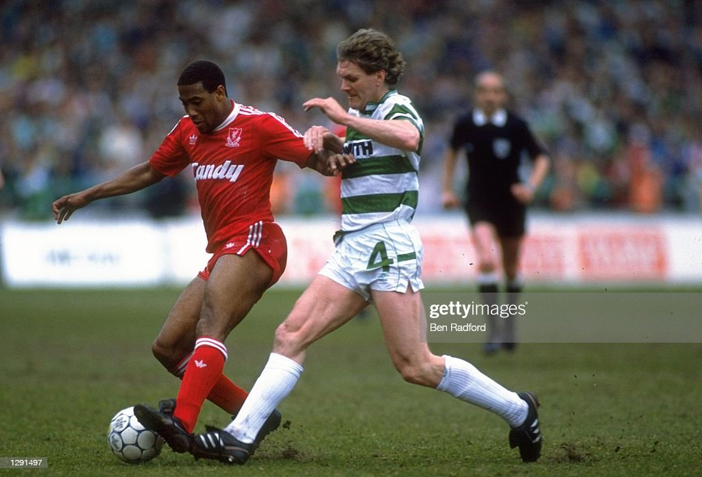 Roy Aitken of Celtic and  John Barnes of Liverpool : News Photo