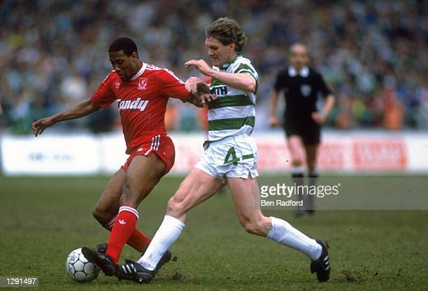 Roy Aitken of Celtic tackles John Barnes of Liverpool during the Sheffield Memorial match at Parkhead in Glasgow, Scotland. Liverpool won the match...