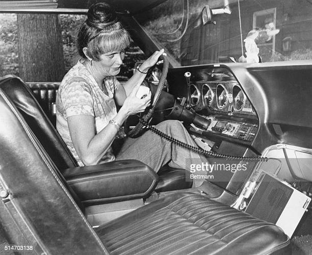 Sitting in her auto Mrs Louise Parsons of Natick Mass uses her CB radio She took the handle Daisy Mae two years ago when she got into CB and now she...