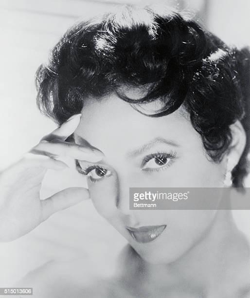 Undated studio headshot of Actress/Singer Dorothy Dandridge hand on her temple