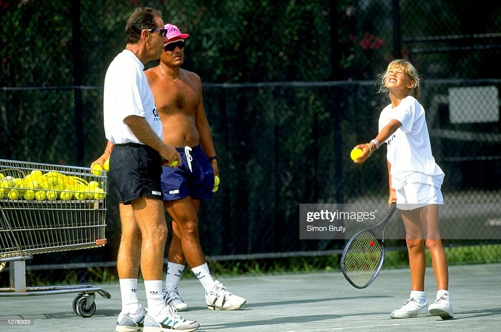 reliable quality new release good service Tennis Coach Nick Bollettieri gives instructions to a young ...