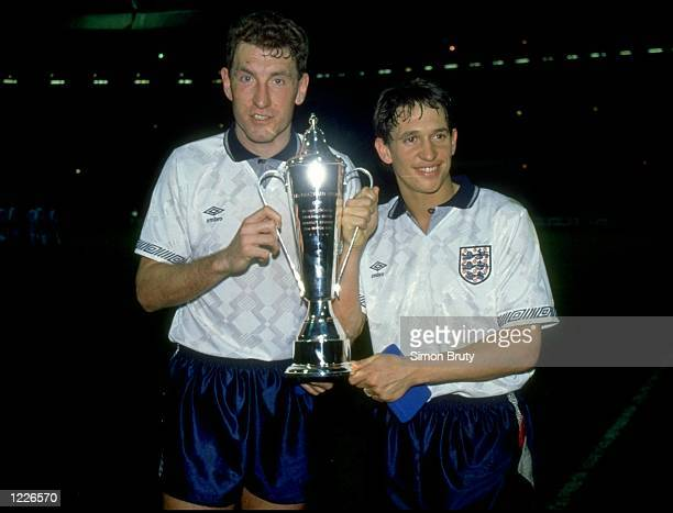 Terry Butcher and Gary Lineker of England hold the trophy after a match against Brazil at Wembley Stadium in London England won the match 10...