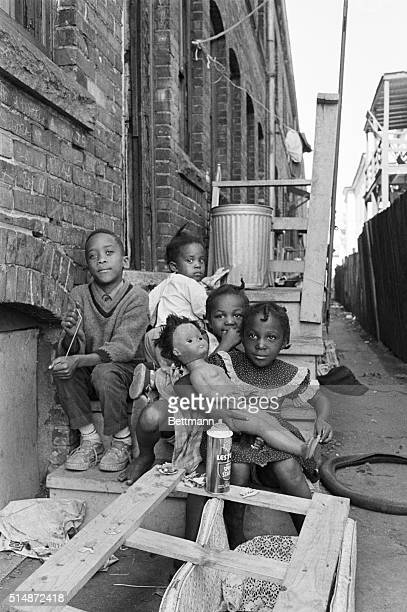 The smell of decay hangs heavy over the streets in the heart of Cleveland's hough district These children are out for some air and play in the back...