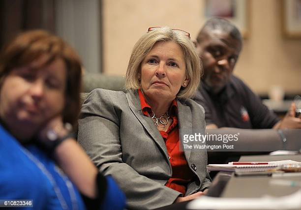 Undecided voters in the presidential election to include from left Cindy Adair Amy Bridges and Rev Kelly Andrews watch the presidential debate as...