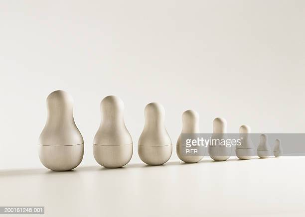 Undecorated Russian dolls in row