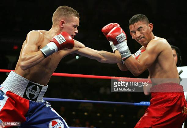 Undefeated featherweight Jason Litzau and Carlos Contreras trade punches during their 10 round featherweight fight Litzau stopped Contreras in the...