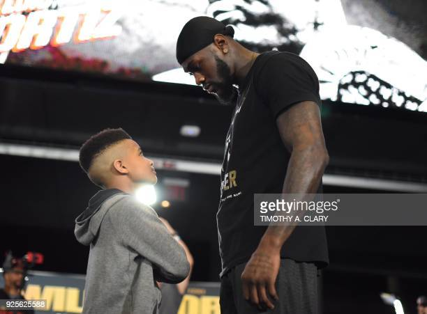 Undefeated heavyweight champion Deontay Wilder poses for pictures with The Young Jamaican Trainer Demarjay Smith during a media workout on February...