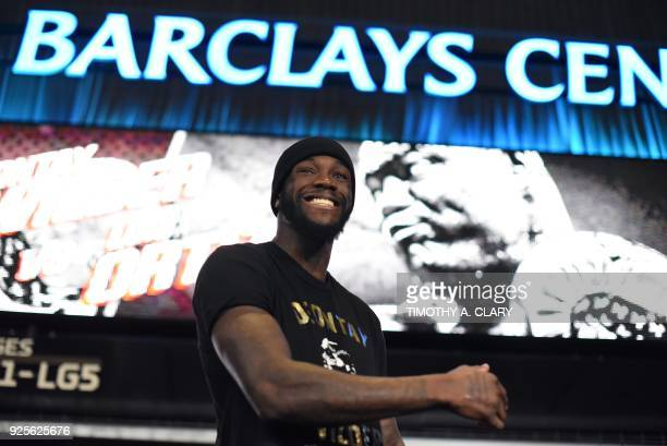 Undefeated heavyweight champion Deontay Wilder throws punches during a media workout on February 28 2018 at the Barclays Center Atrium before his...
