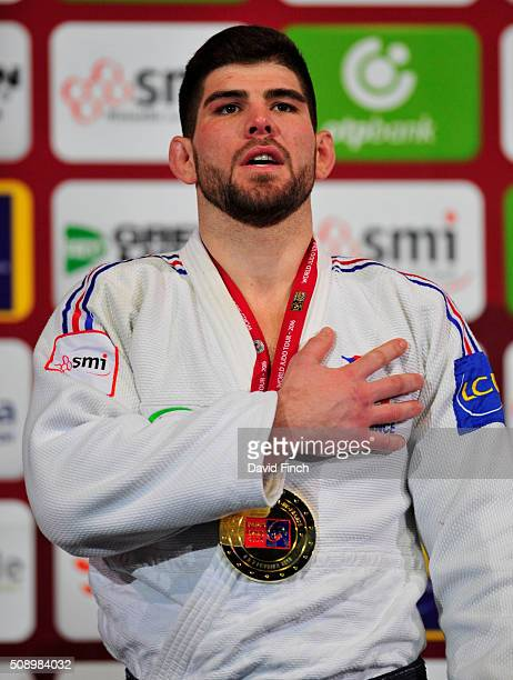 Under 100kg gold medallist Cyrille Maret of France sings to the French national anthem after receiving the medal during the Paris Grand Slam Sunday 7...
