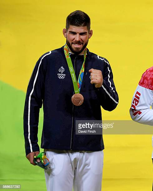 Under 100kg judo bronze medallist Cyrille Maret of France signals his success to his friends after the medal ceremony at the 2016 Rio Olympic Judo on...
