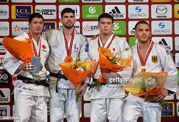 Under 100kg medallists silver Kyle Reyes of Canada gold Cyrille Maret of France bronzes Aaron Wolf of Japan and KarlRichard Frey of Germany during...