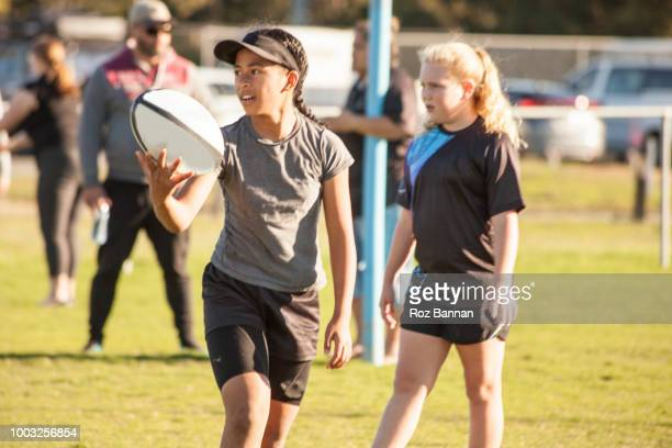 Under 13 girls playing Rugby in Queensland Australia