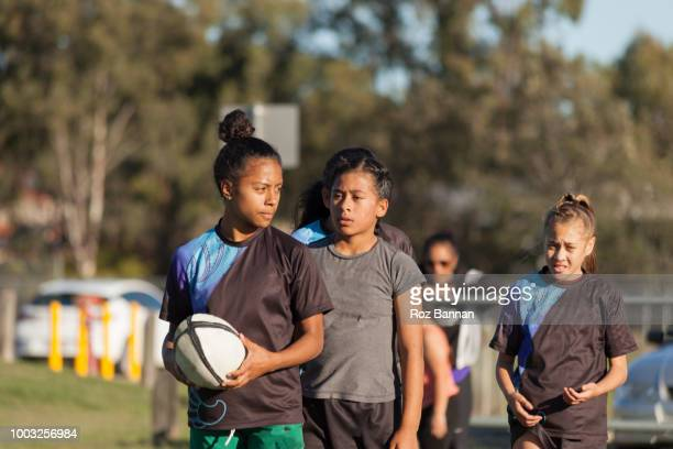 Under 13 girls playing Rugby in Queensland Australia