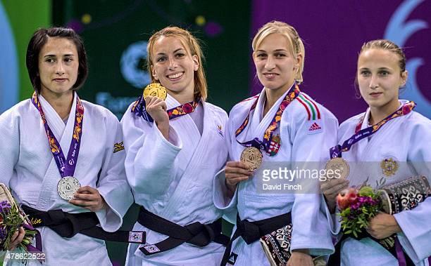 Under 48kg medallists Ebru Sahin of Turkey Charline van Snick of Belgium Eva Csernoviczki of Hungary and Irina Dolgova of Russia pose during the 2015...