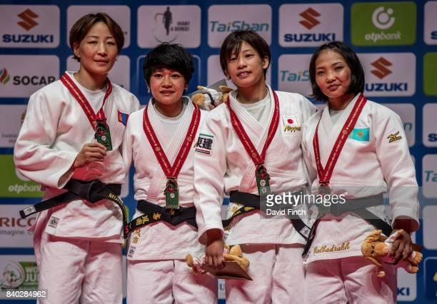 Under 48kg medallists LR Silver Urantsetseg Munkhbat Gold Funa Tonaki Bronzes Ami Kondo and Otgontsetseg Galbadrakh during the 2017 Suzuki World Judo...