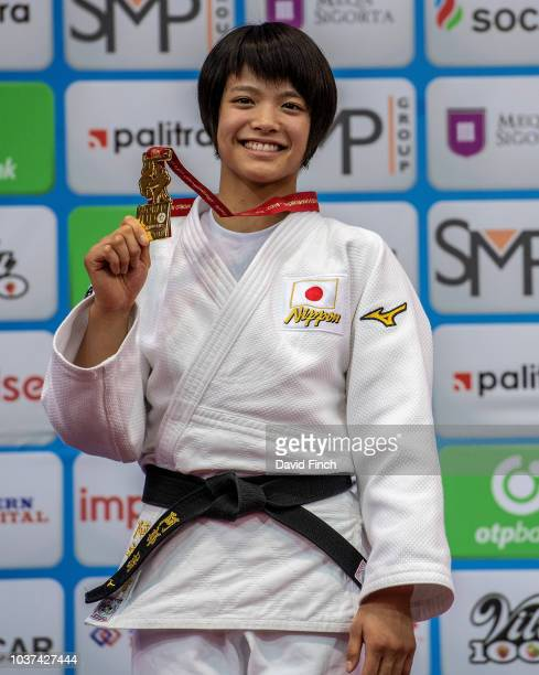 Under 52kg senior gold medallist at 18 Uta Abe of Japan proudly shows her medal during the medal ceremony on day two of the 2018 Judo World...