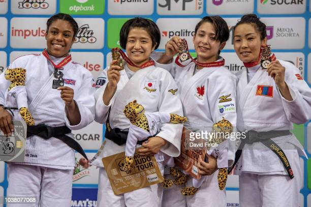 Under 57kg medallists LR Silver Nekoda SmytheDavis Gold Tsukasa Yoshida Bronzes Christa Deguchi and Sumiya Dorjsuren during day three of the 2018...