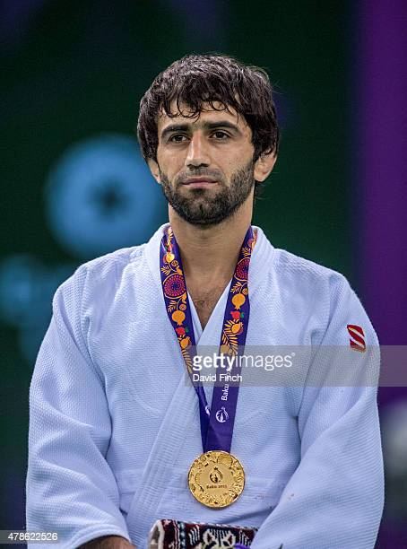 Under 60kg gold medallist, Beslan Mudranov of Russia stands for the Russian National Anthem during the 2015 Baku European Judo Championships at the...