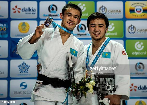 Under 60kg medallists a smiling Ruslam Ibrayev of Kazakhstan who won the silver medal and his fellow countryman Yeldos Smetov who defeated him for...