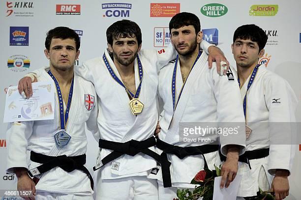 Under 60kg medallists Amiran Papinashvili of Georgia poses with his silver medal, Beslan Mudranov of Russia poses with his gold medal, Hovhannes...