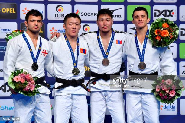 Under 60kg medallists L-R: Silver; Amiran Papinashvili of Georgia, Gold; Boldbaatar Ganbat of Mongolia, Bronzes; Phelipe Pelim of Brazil and...