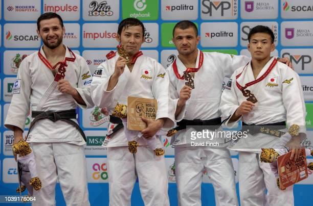 Under 60kg medallists L-R: Silver; Robert Mshvidobadze , Gold; Naohisa Takato , Bronzes; Amiran Papinashvili and Ryuju Nagayama during day one of the...
