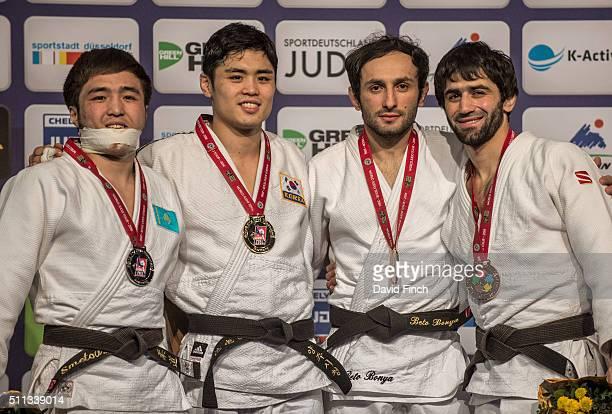 Under 60kg medallists L-R: Silver; Yeldos Smetov of Kazakhstan, Gold; Won Jin Kim of South Korea, Bronzes; Bekir Ozlu of Turkey and Beslan Mudranov...