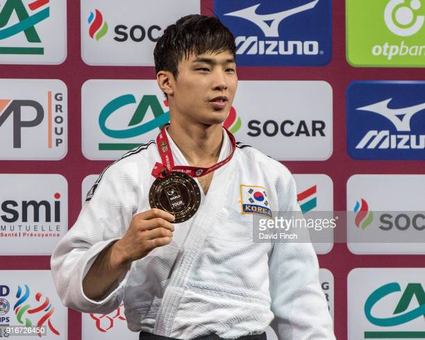Under 66kg gold medallist An Baul of South Korea proudly shows his gold medal during the 2018 Paris Grand Slam at the Accorhotels Arena on February...