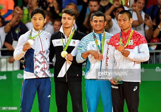 Under 66kg medallists LR Silver BaUl An of South Korea Gold Fabio Basile of Italy Bronzes Rishod Sobirov of Uzbekistan and Masashi Ebinuma of Japan...