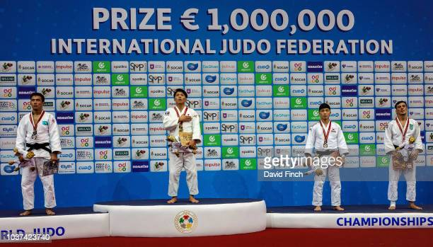 Under 66kg medallists LR Silver Yerlan Serikzhanov Gold Hifumi Abe Bronzes Baul An and Georgii Zantaraia during day two of the 2018 Judo World...