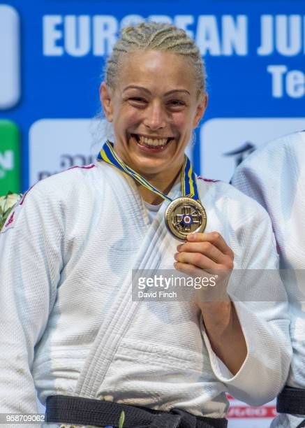 Under 70kg silver medallist Sally Conway of Great Britain happily shows her medal during day two of the 2018 Tel Aviv European Judo Championships at...