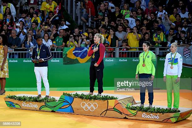 Under 78 kg judo medalists LR Silver Audrey Tcheumeo of France Gold Kayla Harrison of the United States Bronzes Mayra Aguiar of Brazil and Anamari...