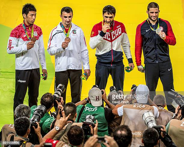 Under 81kg medallists Bronzes Takanori Nagase of Japan and Sergiu Toma of the United Arab Emirates Gold Khasan Khalmurzaev of Russia and Silver...