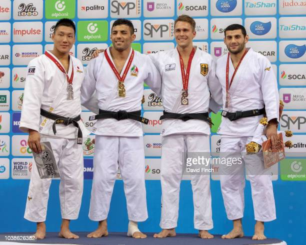 Under 81kg medallists LR Silver Sotaro Fujiwara Gold Saeid Mollaei Bronzes Alexander Wieczerzak and Vedat Albayrak during day four of the 2018 Judo...