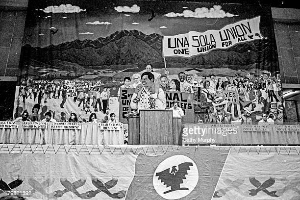 Under a massive banner InterHarvest farm workers representative Armando Ruiz speaks during the United Farm Workers convention Fresno California 1975...