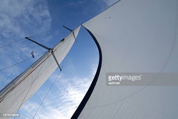 Under a mast and sails