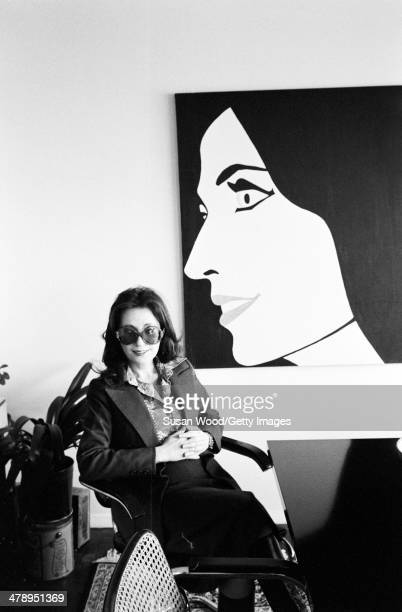 Under a Pop Artstyle painting of herself American businesswoman politician and activist Eileen Preiss poses in her office at Manhattan's First...