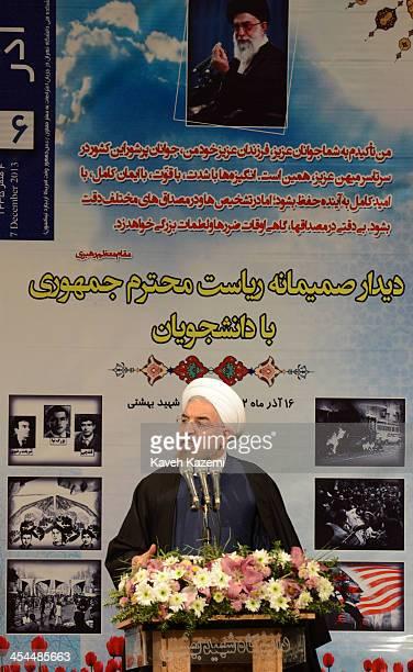 Under a portrait of Iran's supreme leader Ayatollah Ali Khamenei president Hasan Rouhani makes a speech to hardline Basiji and reformist students at...