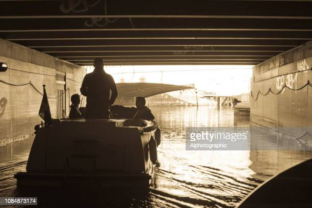 under a road bridge on the main canal in copenhagen - nyhavn stock pictures, royalty-free photos & images
