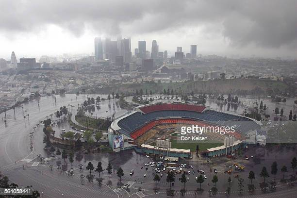 Under a threatening sky the Los Angeles Skyline and in the foreground Dodger Stadium A Pacific Storm will bring the Southland rain and snow Wednesday...
