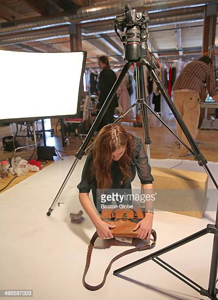Under a tripod with a camera Jess LePrevost lead stylist sets up a product shoot local tech companies that are trying to create marketplaces one of...