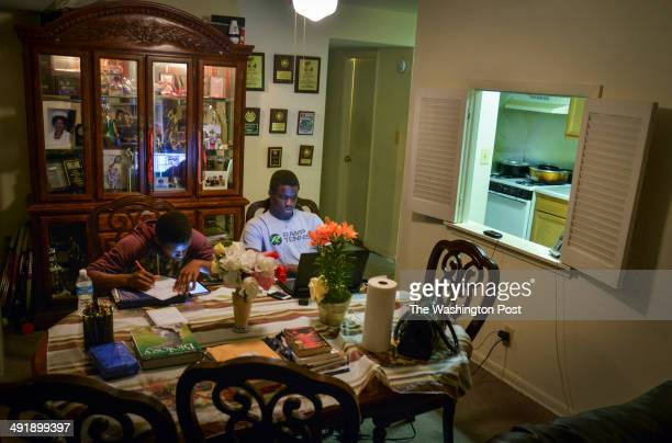 PARK MD MAY Under a wall of pictures and tennis accolades twins Franklin L and Francis Tiafoe share homework space at their home on Monday May 12 in...