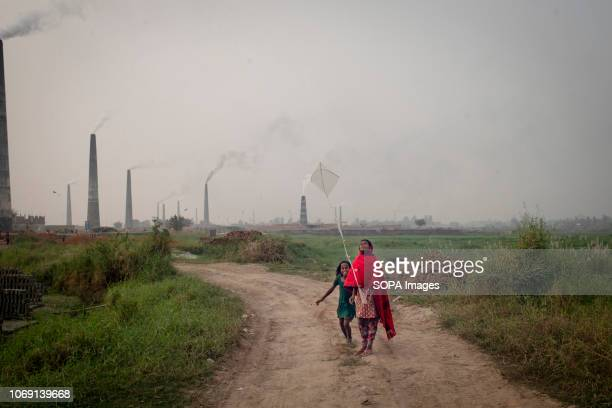 Under age brick field workers are seen playing with kite in the evening Bangladesh is one of the developing country in recent days where the...